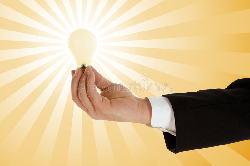 Business idea. Business man with a light bulb, concept of business idea stock photography
