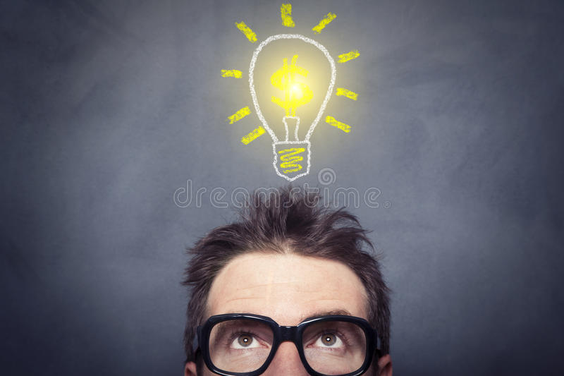 Business Idea. Businessman at front of the blackboard royalty free stock image