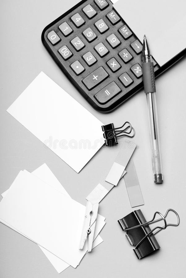 Business idea concept. Bookmarks of different colors near pen. On cyan background, copy space. Stationery and calculator. Business card with empty space and royalty free stock images