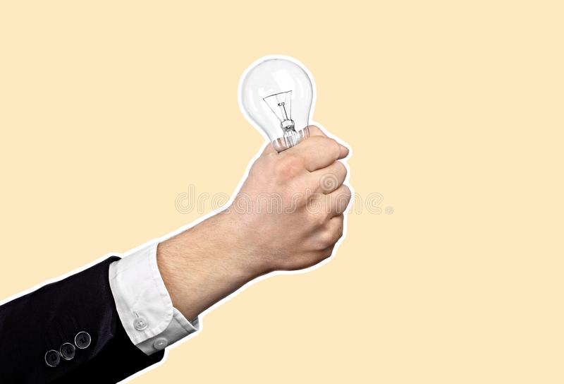 Business idea. Concept. Businessman hand holding light bulb. Magazine style collage with copy space. Abstract creative background royalty free stock photography