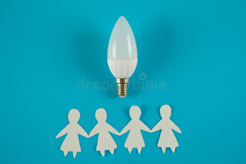 Business idea concept. Businesswomen and lightbulb idea stock photos
