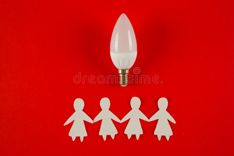 Business idea concept. Businesswomen and lightbulb idea stock photo