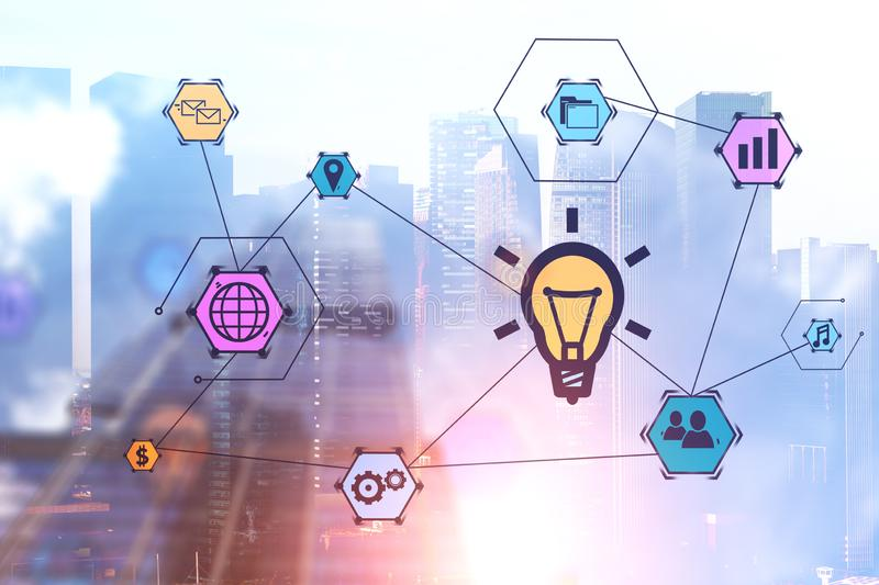 Business idea icons over cityscape background. Bright and colorful business idea icons over morning cityscape background. Concept of creative thinking in stock photo