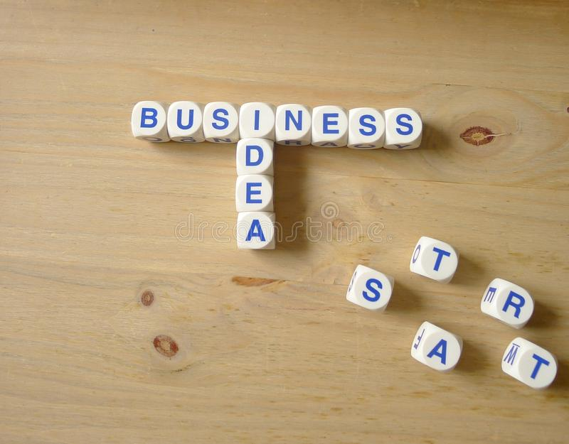 Business Idea. Letters cube wordings with START at the side on wood background stock photo