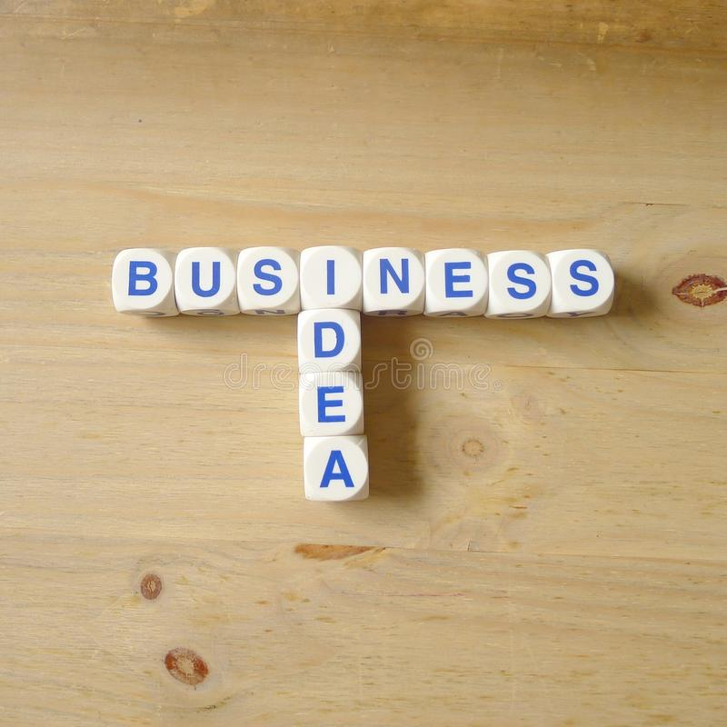Business Idea. Letters cube wordings on wood background royalty free stock photo