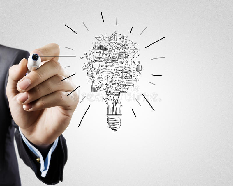 Business ideas. Close up of businessman hand drawing business strategy sketches stock photos