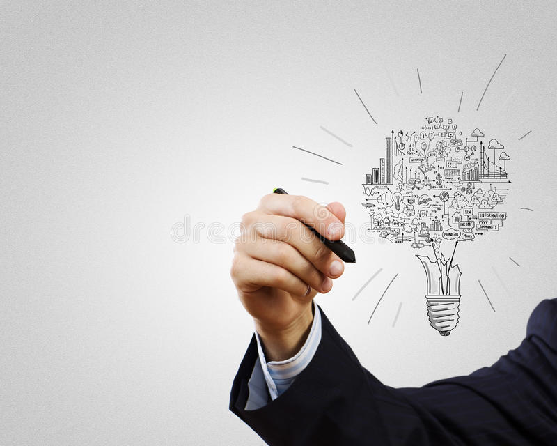 Business ideas. Close up of businessman hand drawing business strategy sketches royalty free stock photo