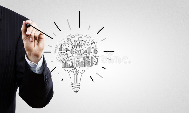 Business ideas. Close up of businessman hand drawing business strategy sketches stock image
