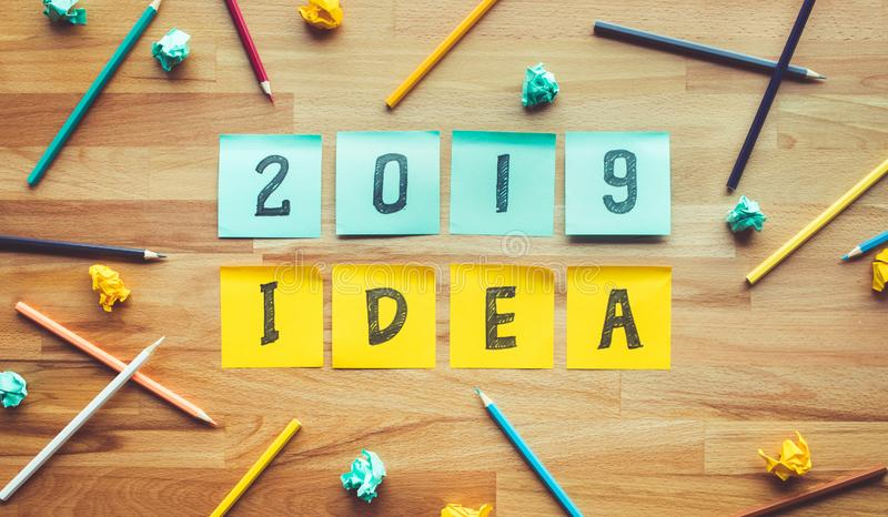 Business ideas 2019 with colorful pencil,notepaper on wood table royalty free stock image