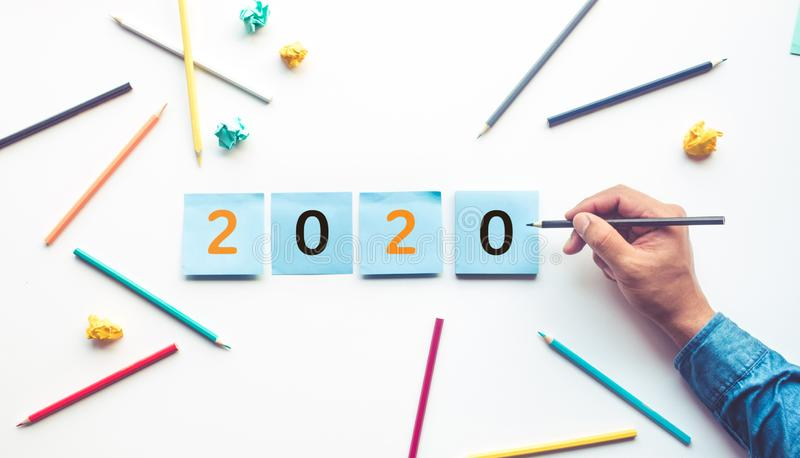 Business ideas 2020 with male hand and pencil,notepaper royalty free stock photography