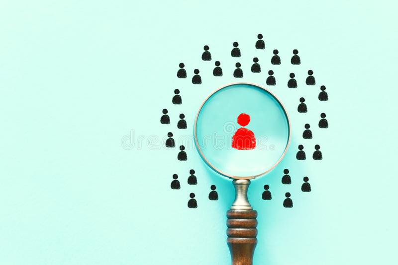 Business image of magnifying glass with people icon over mint table, building a strong team, human resources and management royalty free stock images