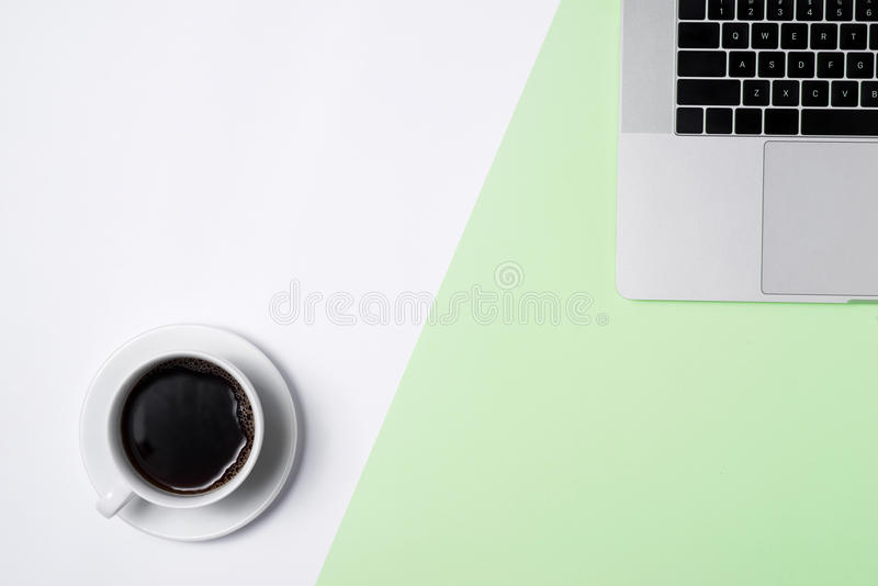 Business image. Pastel office desk table with laptop, and supplies. Top view with copy space stock images
