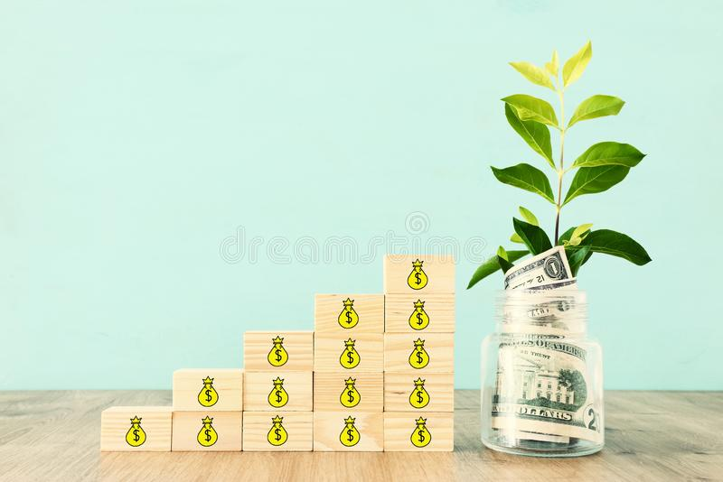 Business image of plant growing in savings jar, money investment and financial growth concept.  royalty free stock photo