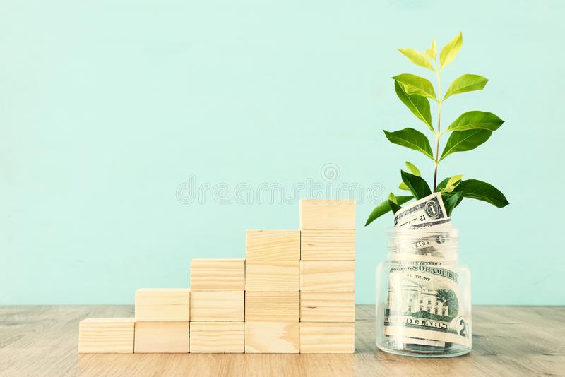 Business image of plant growing in savings jar, money investment and financial growth concept.  royalty free stock photography
