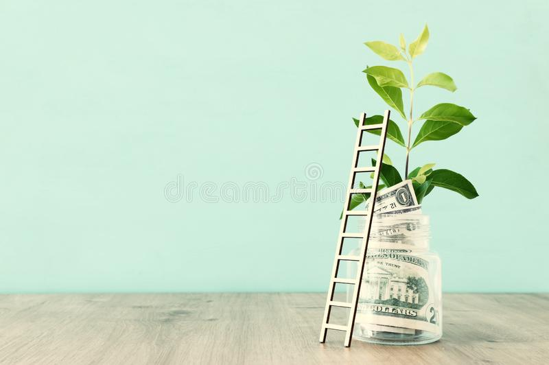 Business image of savings jar and ladder, money investment and financial growth concept.  royalty free stock photography