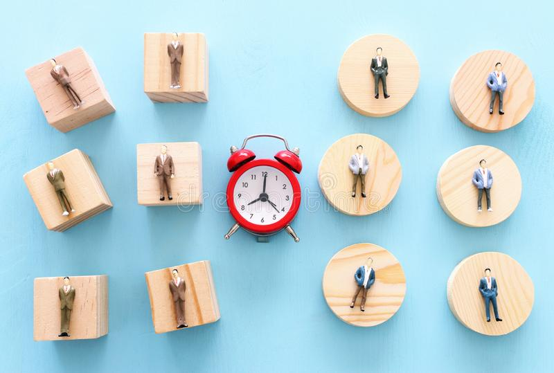 Business image of time management concept. Group of people and alarm clock, deadline and teamwork metaphor royalty free stock photo