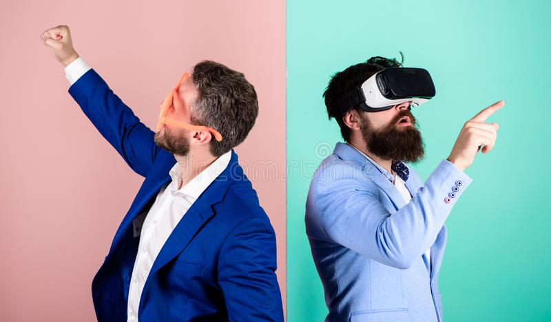 Business implement modern technology. Man with beard in VR glasses and louvered plastic accessory. Guy interact in. Virtual reality. Hipster exploring virtual royalty free stock images