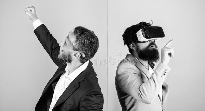 Business implement modern technology. Real fun and virtual alternative. Man with beard in VR glasses and louvered. Plastic accessory. Guy interact in virtual royalty free stock images