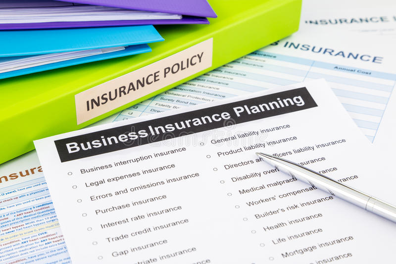 Business insurance planning checklist for risk management. Business insurance planning checklist with documents and binders, concept for risk management stock image