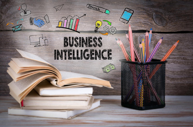 Business Intelligence. Stack of books and pencils on the wooden table. royalty free stock photos