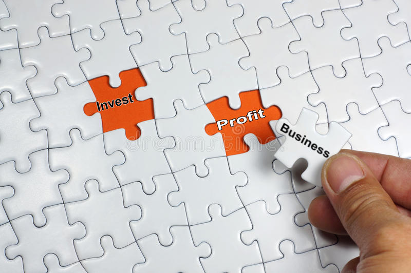 Business Investment Profit. Word on puzzle royalty free stock photo