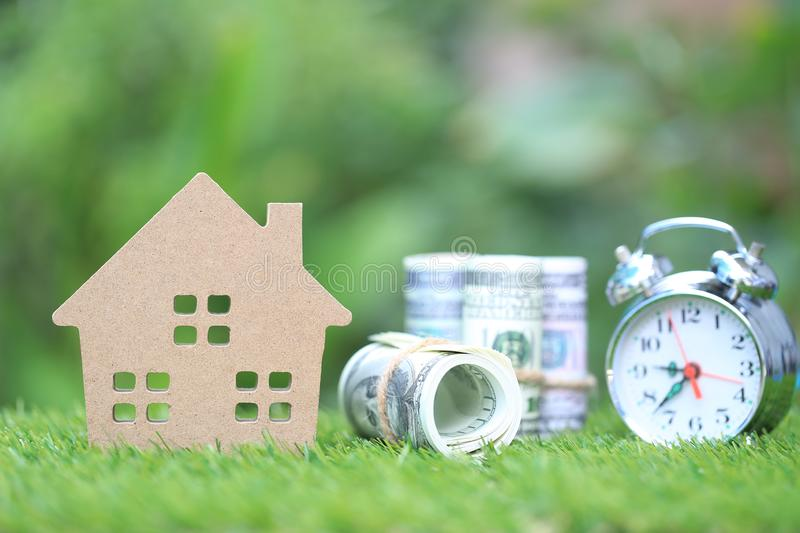 Business investment and real estate, Model house with banknote on natural green background, Saving for prepare in future.  royalty free stock photography