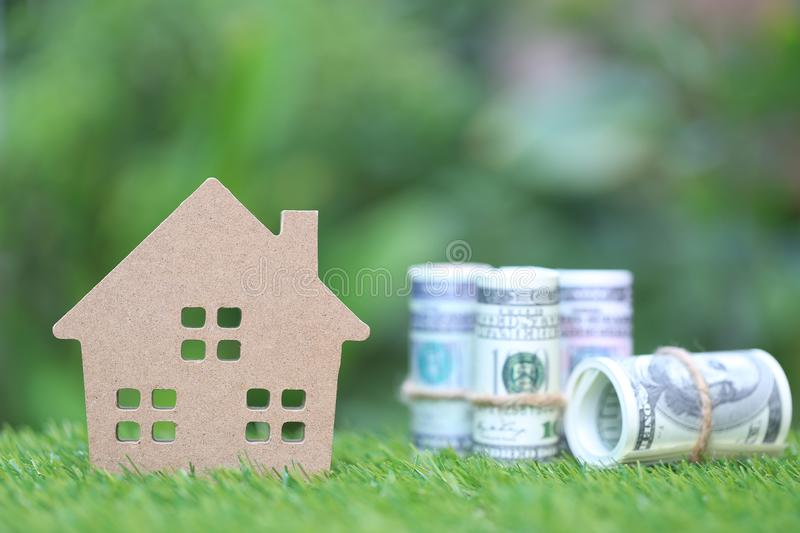 Business investment and real estate, Model house with banknote on natural green background, Saving for prepare in future.  royalty free stock photo
