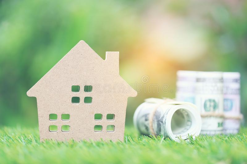 Business investment and real estate, Model house with banknote on natural green background, Saving for prepare in future.  royalty free stock image