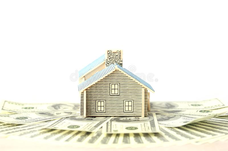 Business investment and real estate, Model house on banknote on white background, Saving for prepare in future.  royalty free stock photo