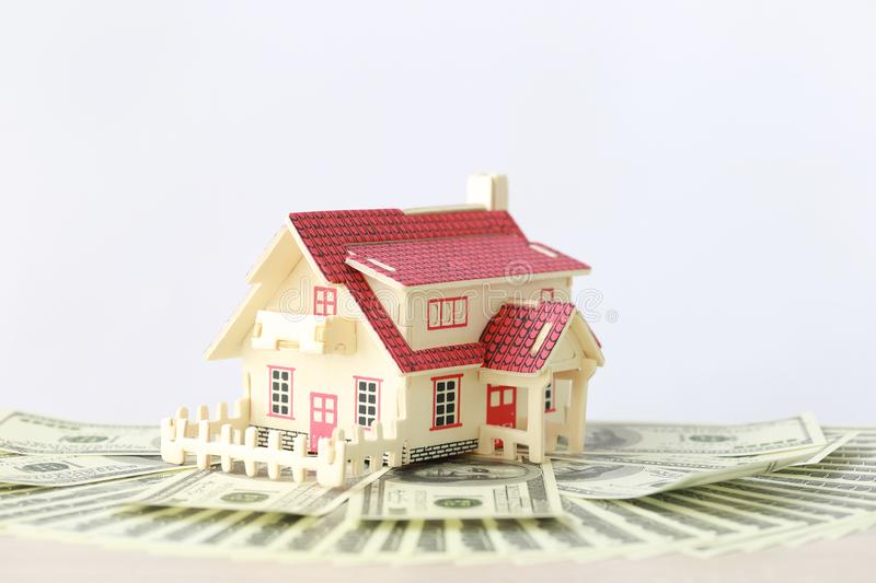 Business investment and real estate, Model house on banknote on white background, Saving for prepare in future.  royalty free stock photos