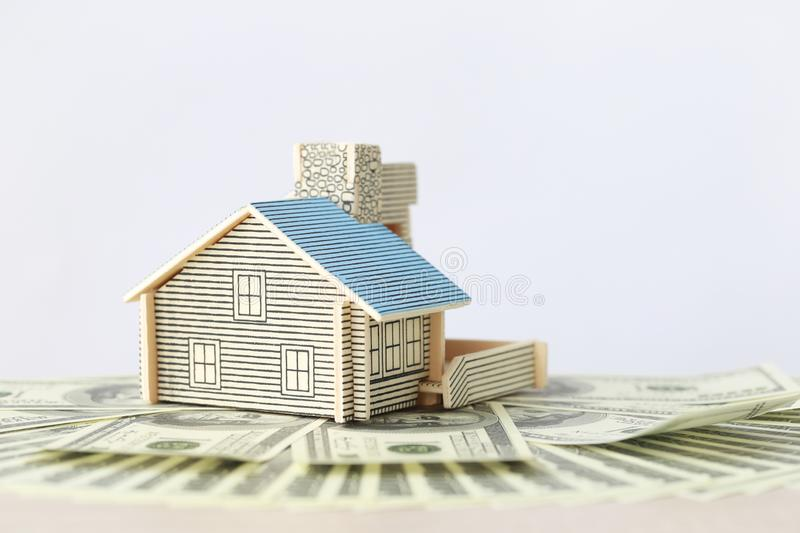 Business investment and real estate, Model house on banknote on white background, Saving for prepare in future.  stock image