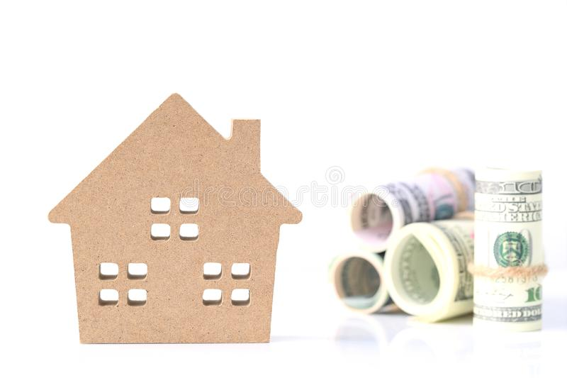 Business investment and real estate, Model house with banknote on white background, Saving for prepare in future.  stock photos