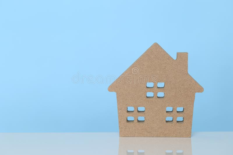 Business investment and real estate, Model house on blue background.  royalty free stock photos