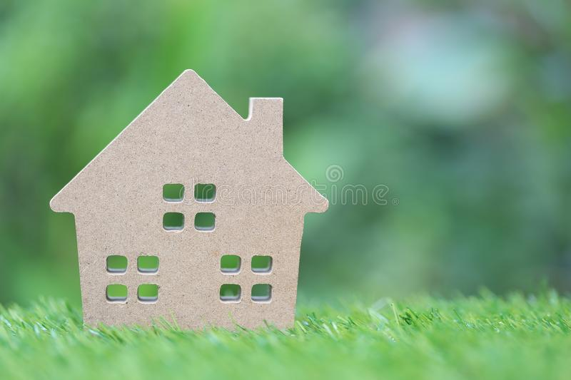 Business investment and real estate, Model house on natural green background.  stock photo