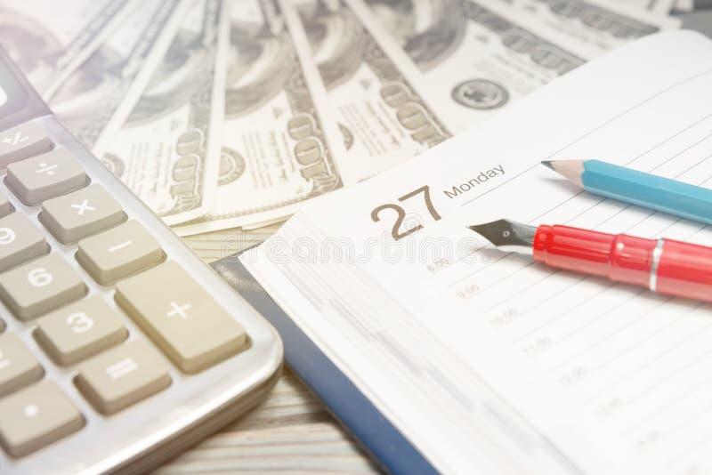 Business items on your desktop. Calendar dollars calculator. Concept finance royalty free stock image