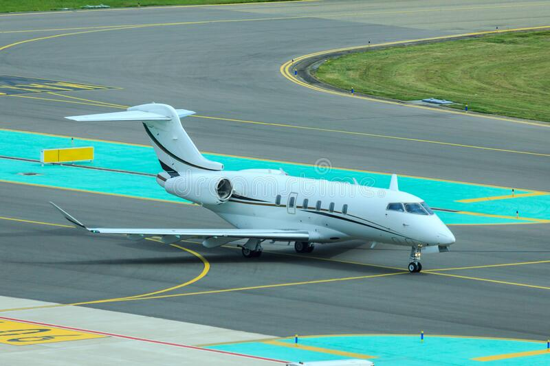 Business jet taxiing at airport royalty free stock image