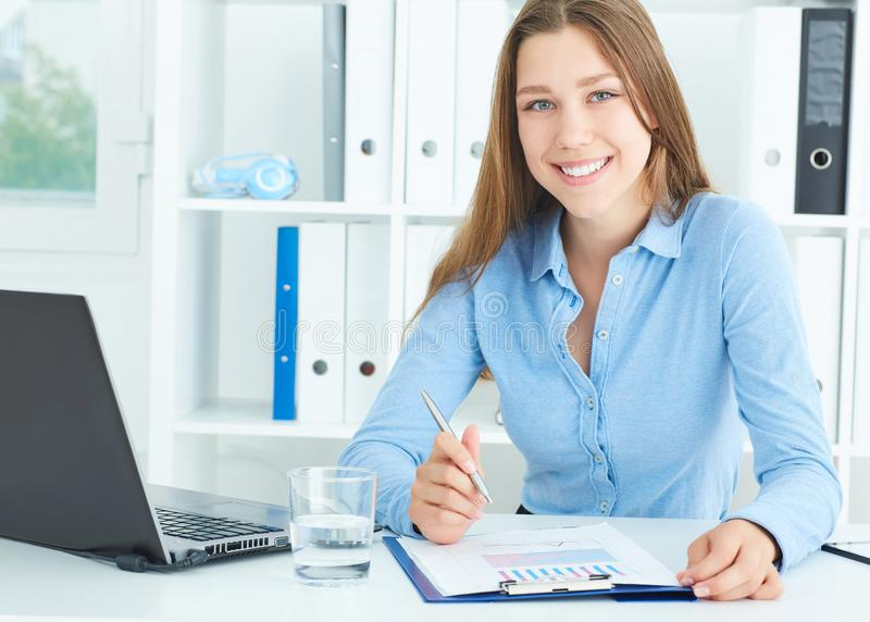 Portrait of smiling secretary in office. Business job offer, financial success, certified public accountant concept. royalty free stock image