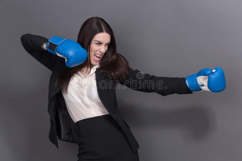 Business lady in boxing gloves royalty free stock photos