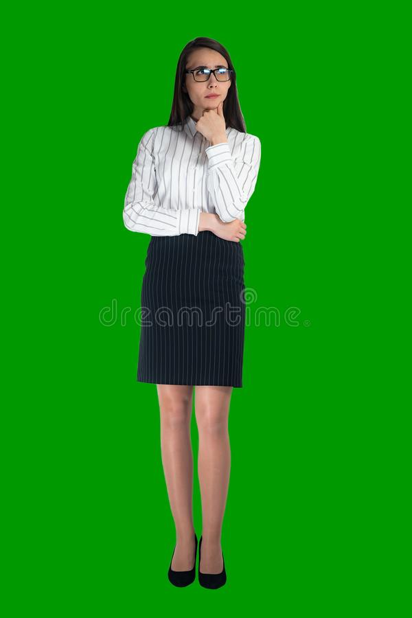 Business lady with glasses looking thoughtfully stock photography