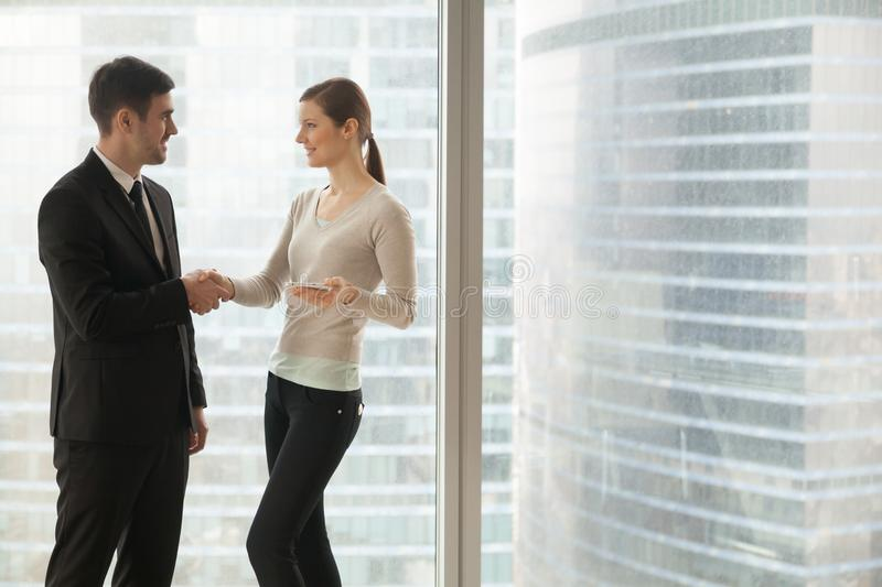 Business lady handshaking with partner in office stock images