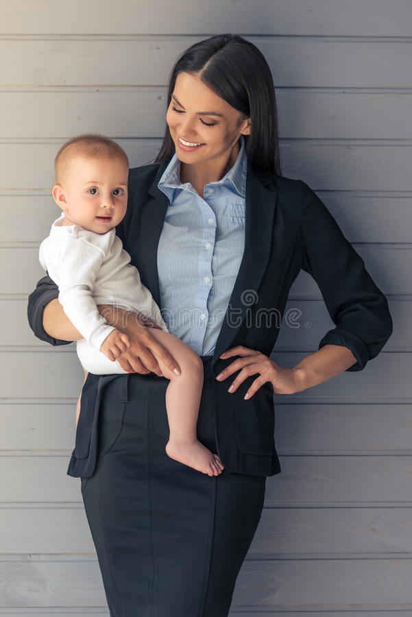 Business lady with her baby royalty free stock photos