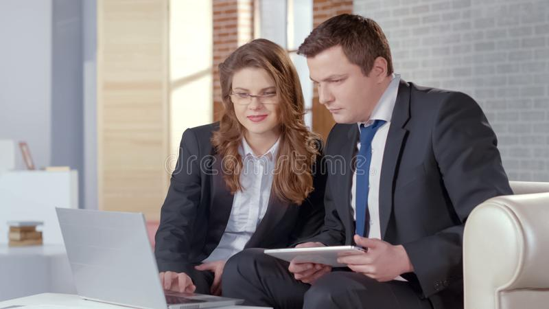 Business lady and man checking presentation on laptop, collaborate in business royalty free stock images