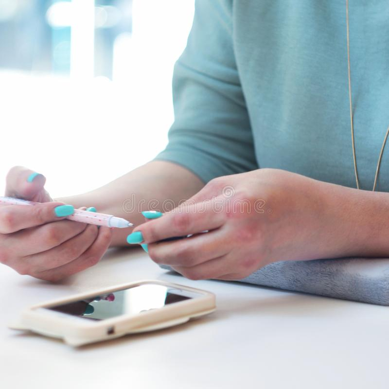 Business lady with a pen and phone royalty free stock photo