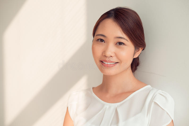 Business lady. Portrait of young Japanese business lady smiling at the camera royalty free stock images
