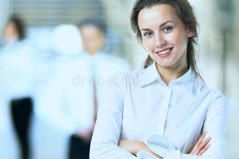 Business lady with positive look and cheerful smile posing stock images