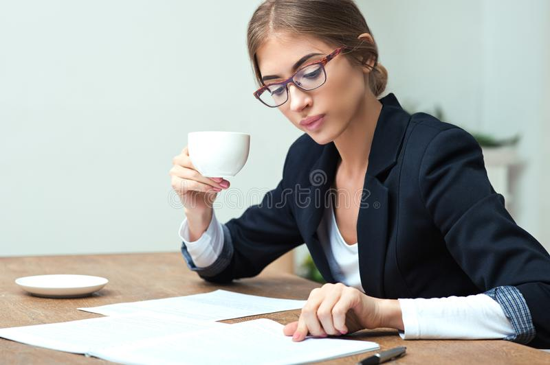 Business lady reading documents royalty free stock photo