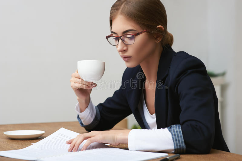Business lady reading documents stock images