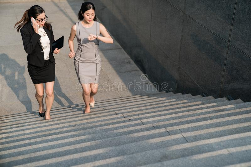 Business lady rushing on the stairs. royalty free stock photos