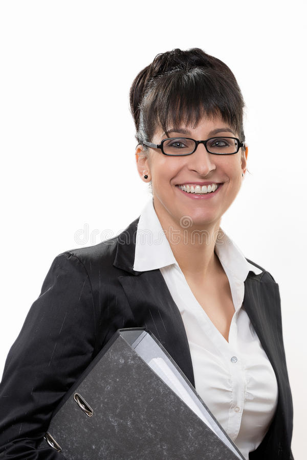 Business lady smiles. Business lady has a folder in the arm and smiles stock photo