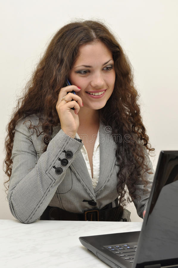Business lady talking on the phone royalty free stock photo